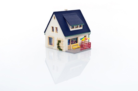 doll house: miniature house on white background