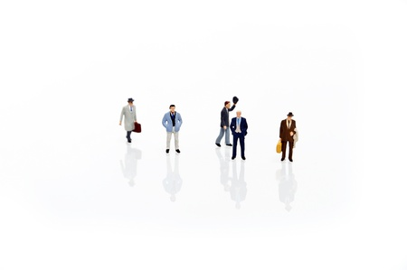 miniature man in one row Stock Photo - 12664582