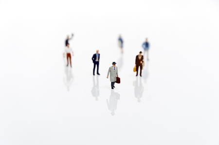 miniature man in one row Stock Photo