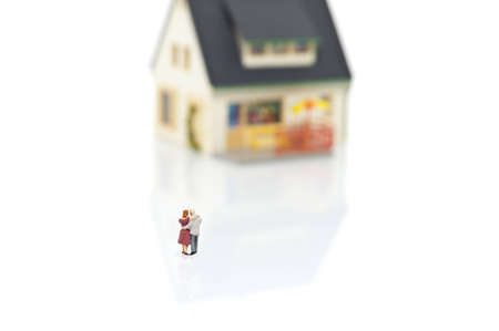 miniature people with house photo