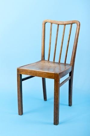 wooden chair on blue background photo