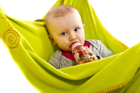 baby eat from bottle in green blanket photo