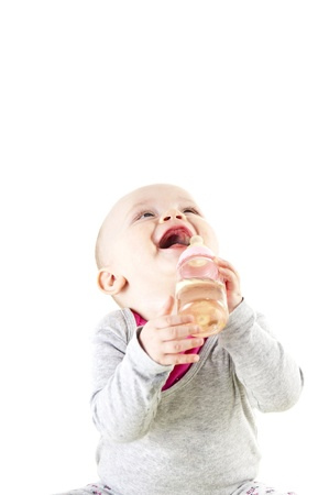 baby eat from bottle and look up