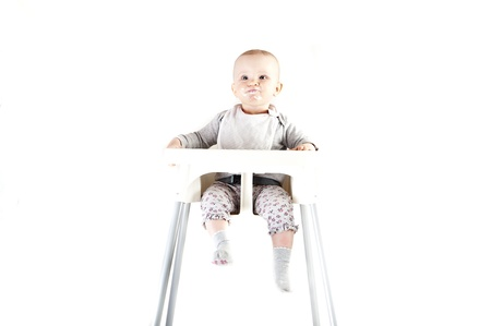 baby in seat and eating Stock Photo - 13399424