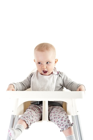 baby in seat and eating photo