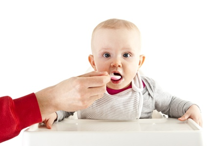 baby in seat and eating Stock Photo - 13400720