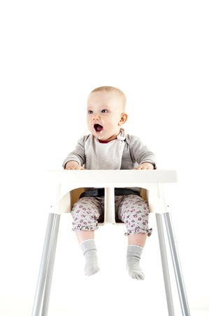 baby in seat and eating Stock Photo - 13400147