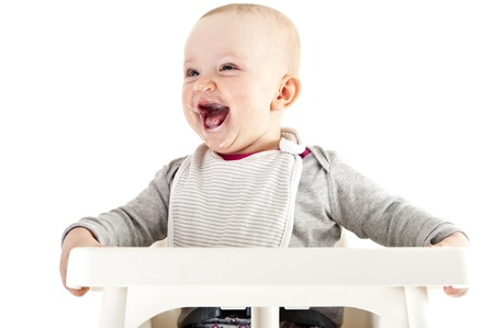 baby in seat and eating Stock Photo - 13400594