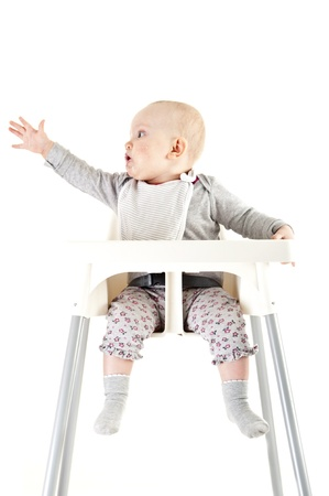baby in seat and eating Stock Photo - 13400574