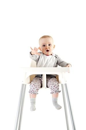 ni�os comiendo: beb� en el asiento y el comer Foto de archivo