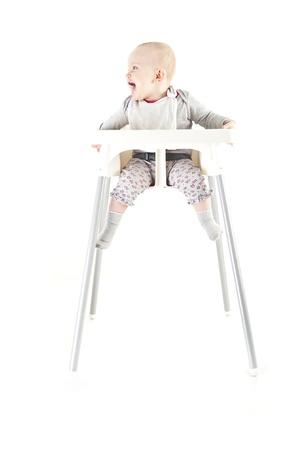 baby in seat and eating Stock Photo - 13399390