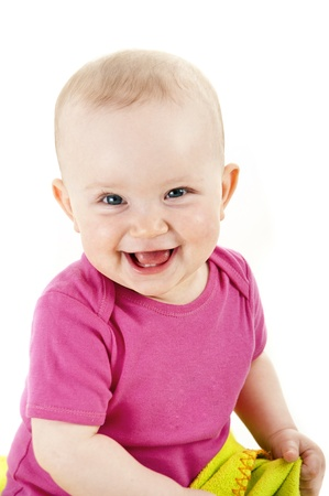 baby smiling and looking ahead Stock Photo