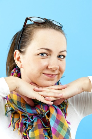 woman on blue background holding Stock Photo - 13612331
