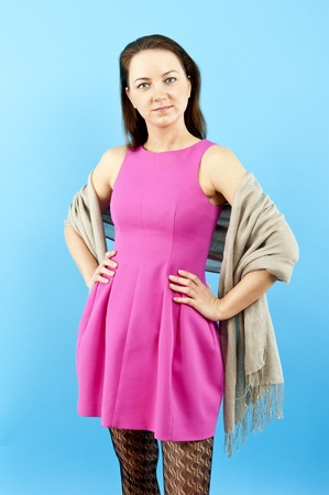 woman in pink dress on blue background Stock Photo - 13612328