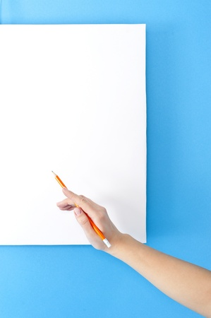 woman hand with pencil on blank space photo