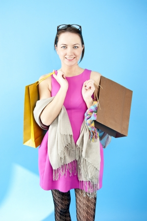 woman on shoping on blue background Stock Photo - 13612330