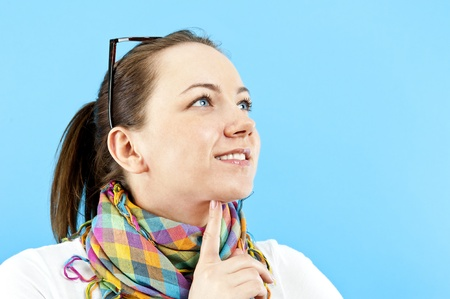 woman on blue background pointing somthing photo