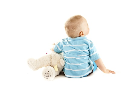 baby siting on white background with bear
