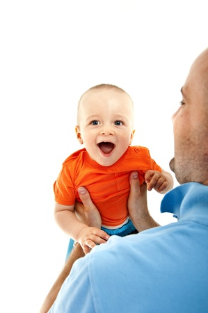 baby playing with father in white background photo