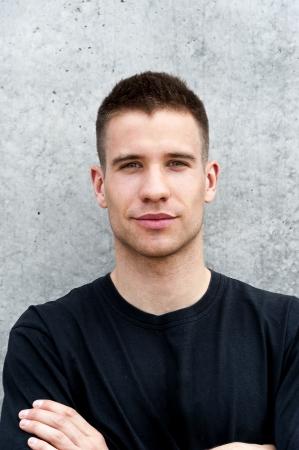 man standing near the wall photo