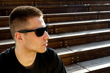 man on the stairs with sunglasses photo