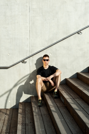 man on the stairs with sunglasses Stock Photo