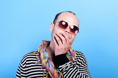 mad man with glasses on blue background photo