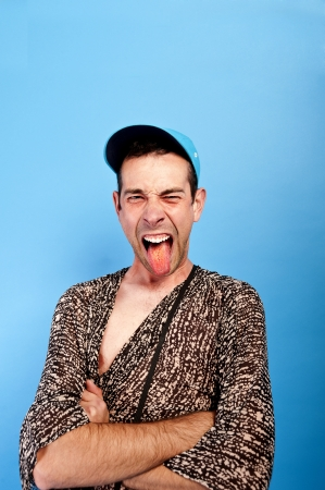 man with funny face and on the blue background photo