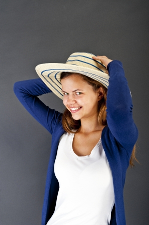 Woman with hat on her head on black background photo
