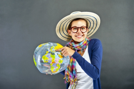 Teenager girl with world ball photo