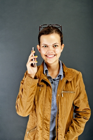 Teenager girl with mobile phone photo