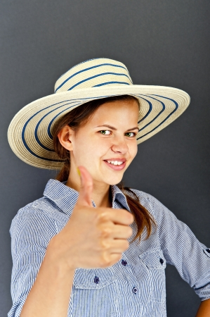 Woman with ok thumb photo