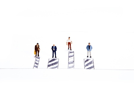 Miniature people on white background Stock Photo - 16256618