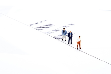 Miniature people on white background photo