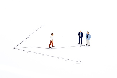 Miniature people on white background Stock Photo - 16256611