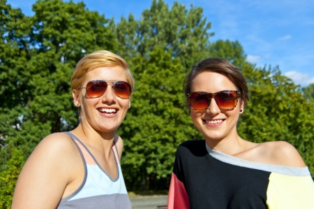 Two beautiful woman with sunglasses Stock Photo - 16375050