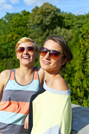 Two  beautiful woman with sunglasses Stock Photo - 16375040
