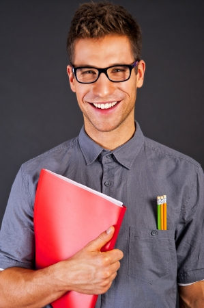 Portrait of funny nerd man with pencyls and glasses photo
