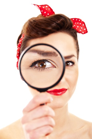 Woman with magnifier on white background photo