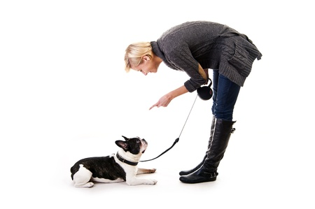 Woman with her dog on leash over white background photo