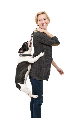 Woman with her dog playing photo
