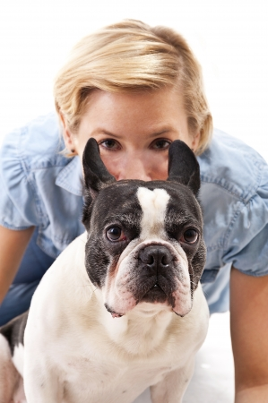 Woman with her dog over white background photo