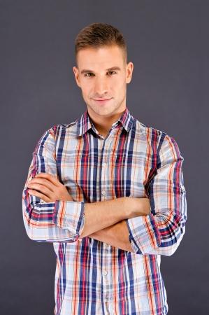 Man overdark background in squared shirt Stock Photo