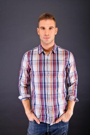 Man overdark background in squared shirt Stok Fotoğraf
