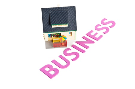 minature: Business word with minature house