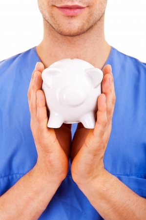 hospital fees: Doctor with Caring Hands on a Piggy Bank.