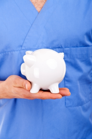 hospital fees: Doctor Holding Piggy Bank Abstract