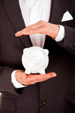 Business man and piggy bank isolated on white background photo