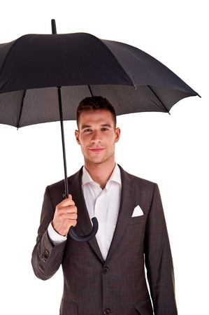 Full length portrait of businessman with opened umbrella photo