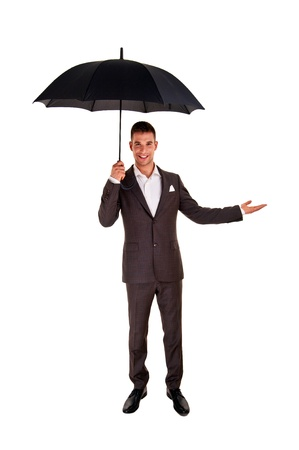 Young business man with an umbrella checking the rain on